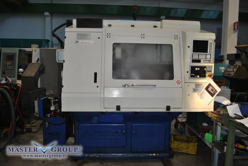 TORNIO CNC A 6 ASSI COMPLETO DI CARICABARRE - USATO - CAMI - B60V