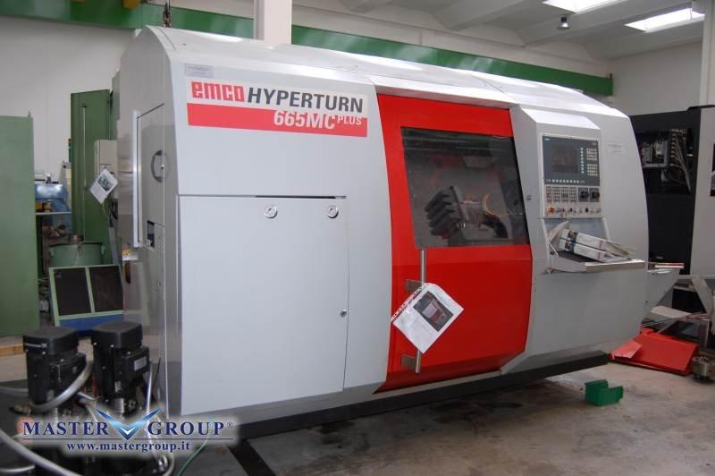 TORNIO CNC A 4 ASSI CON DOPPIA TORRETTA COMPLETO DI CARICABARRE - USATO - EMCO - HT 665