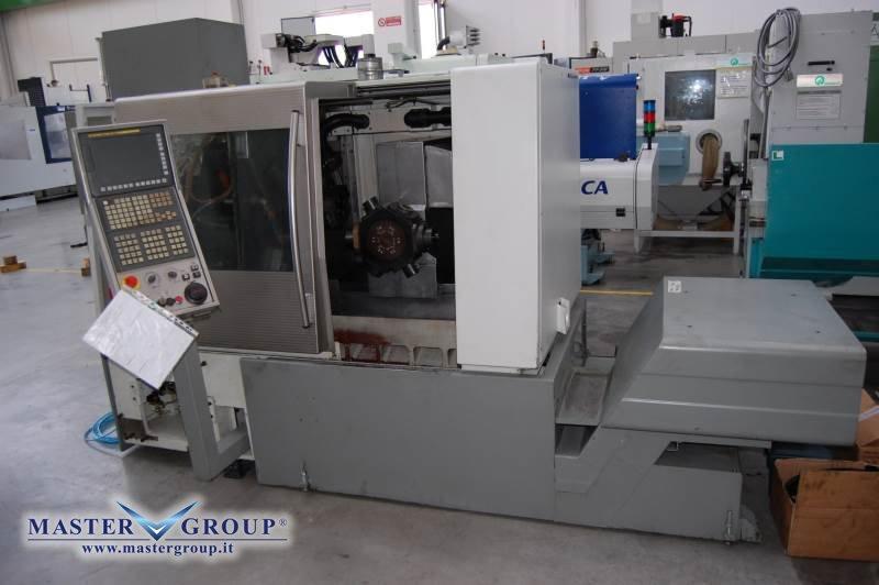 TORNIO CNC A 7 ASSI COMPLETO DI CARICABARRE - USATO -  DMG - GILDEMEISTER MSL 42-7