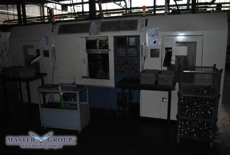 TORNIO CNC BIMANDRINO A 2+2 ASSI CON MAGAZZINO CARICO/SCARICO - USATO -  TAKAMAZ - XW 100